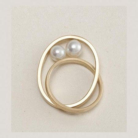 This ring is totally stunning. So simple and elegant with 2 beautiful white natural pearls featured between the 2 rings. The perfect ring!