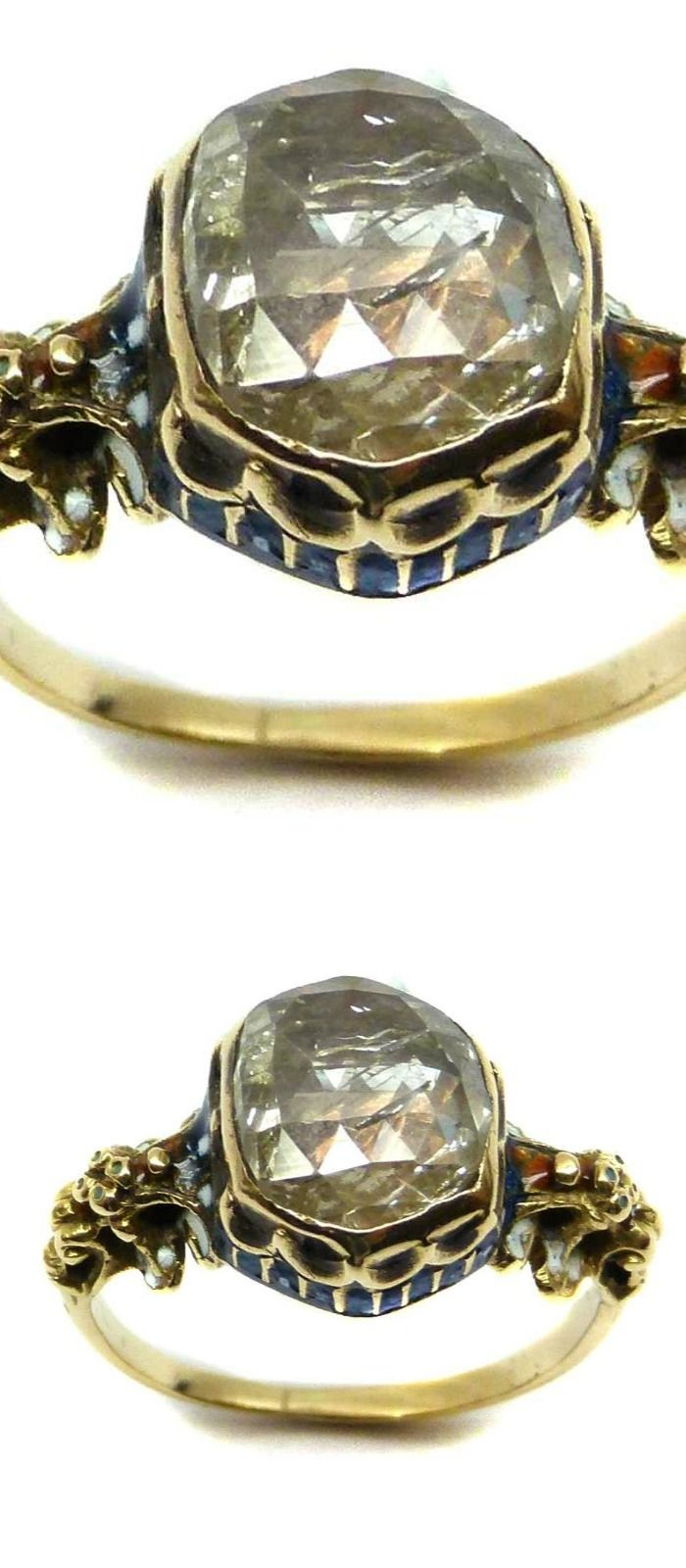 17th century rose cut diamond, enamel and gold ring, English c.1650, the diamond close collet set within an hexagonal bezel, the gallery with moulded scroll detail and blue and white enamel, scrolled shoulders with traces of white enamel, a butterfly engraved to the back of the collet. Via SJ Phillips.