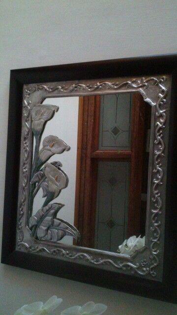 Espejo repujado