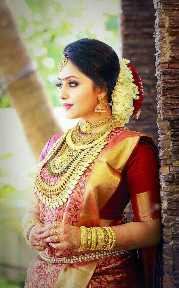 Gold queen   South indian wedding hairstyles, Indian bridal hairstyles, Kerala bride