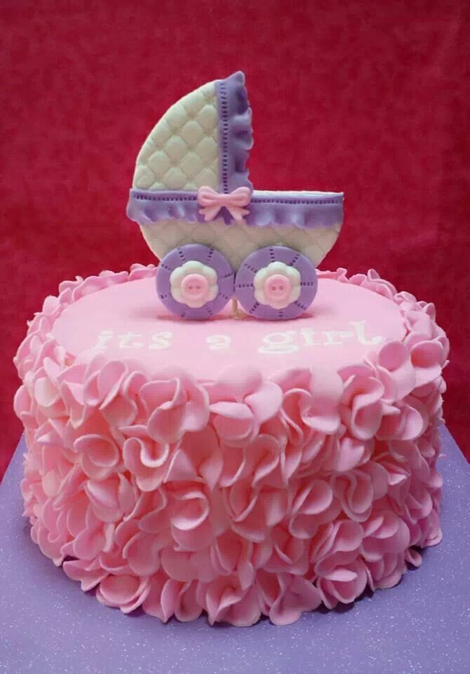 Beautiful Pink Ruffled Cake with Baby Carriage Topper.