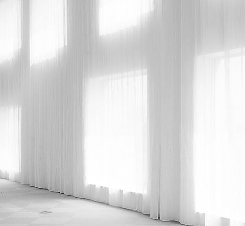 Beautiful, subtle light entering through semi-transparant curtains. Interior of the Zollverein School of Management and Design by Sanaa.