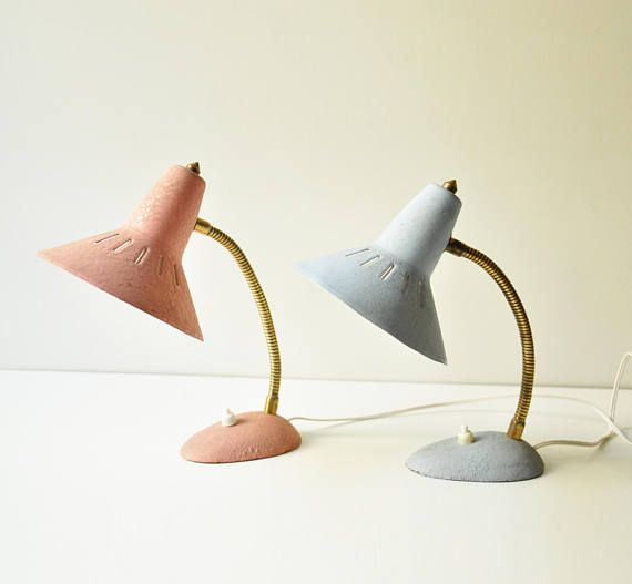 This lovely set of two midcentury modern bedside lamps is perfect for a pastel vintage themed bedroom decoration!  The two adorable small gooseneck lamps are in pink and baby blue colour. They are both rewired.  Dimensions: Height: 24 cm  They do show a few signs of wear consistent with their age.  The lamps have european plugs but if you wish we can include american plug adaptors, just let us know! The listing includes two light bulbs.  As legal notice we remind you that all the lamps & ...