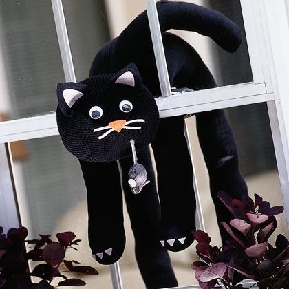 Black Magic Cat: This slinky kitty makes a spooky Halloween decoration