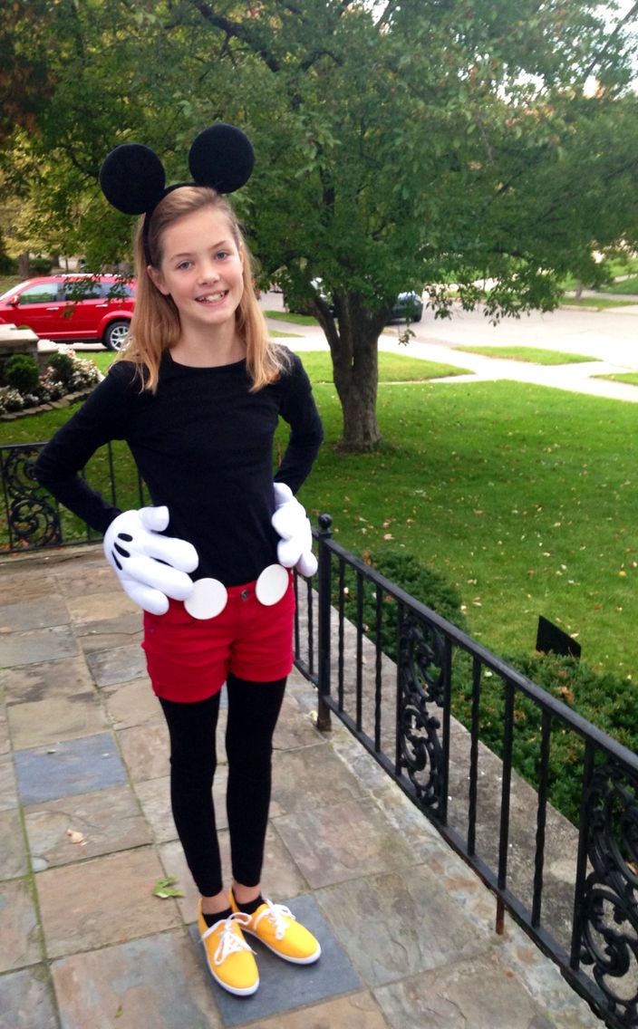 Mickey Mouse Halloween costume for tween girl :)  Ears and gloves bought from the Halloween store in a set. Solid black shirt, black leggings. Bought red pants at the thrift store, cut them into shorts. The white circles are balsam wood, spray painted. I hot glued alligator clips to them and they are just clipped on the belt loops.  Yellows shoes from Amazon - $12.00  Voila!