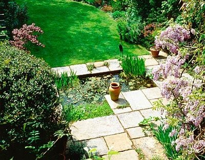 PAVED TERRACE, FORMAL POOL AND LAWN. DESIGNER: SHEILA STEDMAN