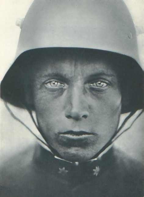 Portrait of a Austrian Hungarian Lance Corporal soldier c.1918 wearing a Stahlhelm helmet - WW1 1000 yard stare