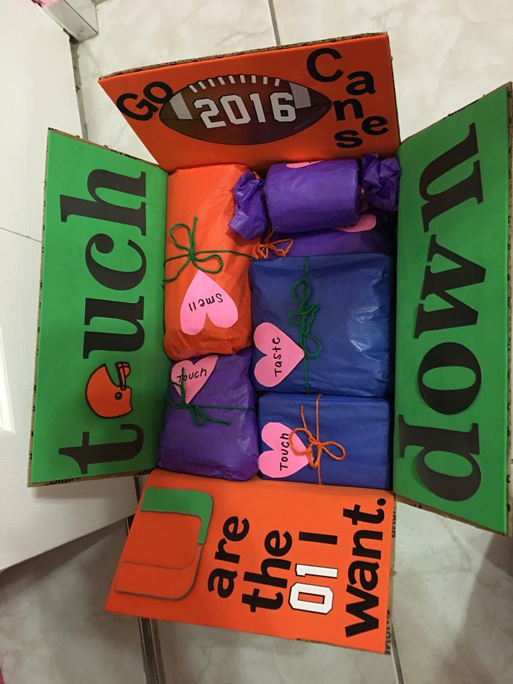 Care package I made for my boyfriend in the army who is obsessed with the University of Miami football team.   All the contents are gift wrapped and labeled with one of the five senses. At the very bottom there's a note telling him how even 6,000 miles away, he can still taste, smell, see, hear, and touch home.