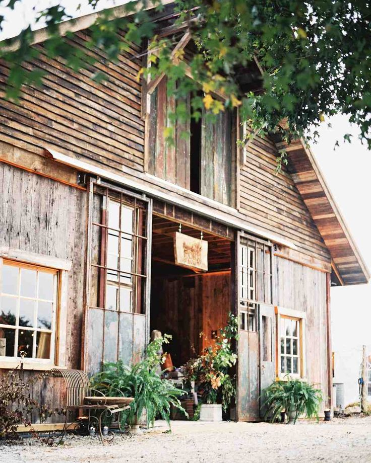 An Elegant-Meets-Rustic Farm Wedding in North Carolina   Martha Stewart Weddings - The barn, built by a local carpenter, was outfitted with foliage- and flower-filled urns for the event.