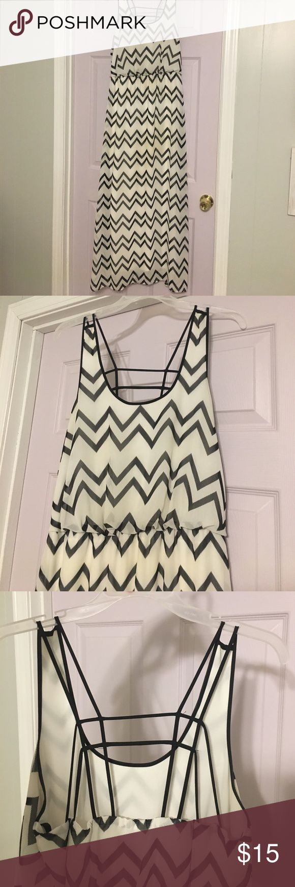 Black and White Chevron Maxi Dress This cute black and white chevron maxi dress is sheer and fully lined! The back is open with a criss cross detail. It is in good condition! only worn a few times, with no stains or tears. It would be the perfect addition to your spring or summer wardrobe! City Triangles Dresses Maxi