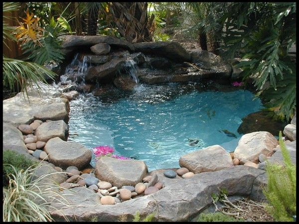 here's that grotto hot tub look i want!  well, it's a bit more of a tropical feel with the plants they've got here than i have in mind, but overall this really works, and i'd feel happy and relaxed here.