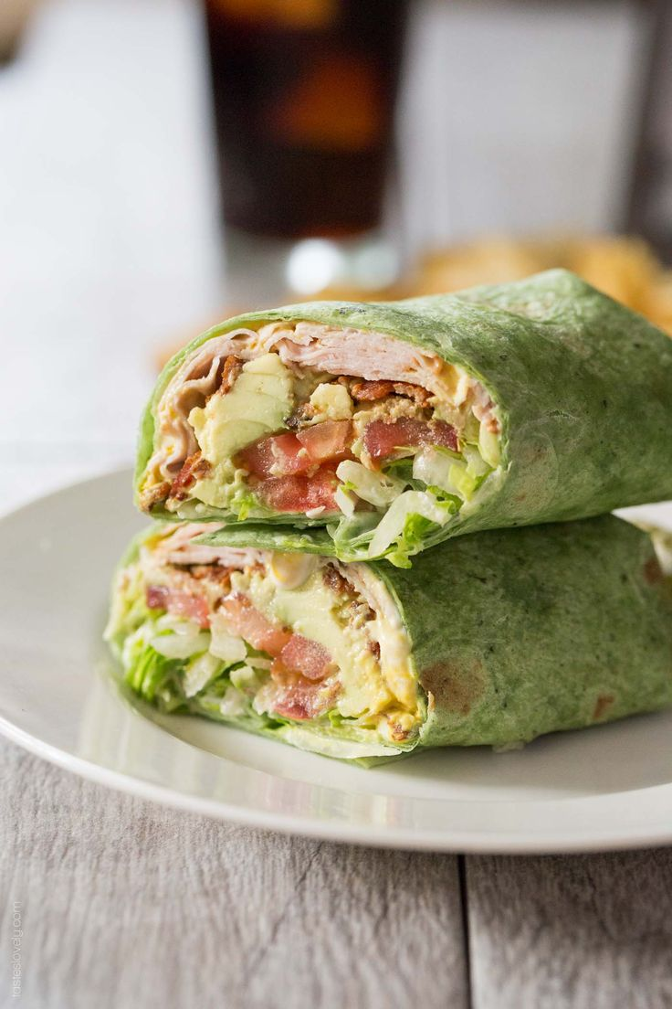 "California Turkey Club Wrap - sub ""spinach tortilla"" with a whole wheat tortilla since ""vegetable wraps"" hardly include veggies at all and are usually colored with dyes."