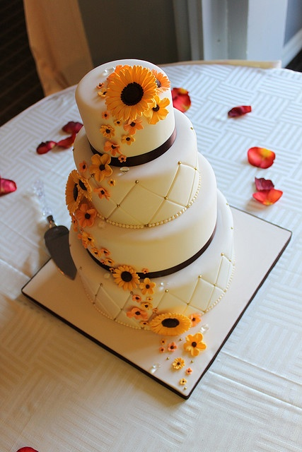 Diamond embossed wedding cake with Sunflowers by Andrea's SweetCakes, via Flickr