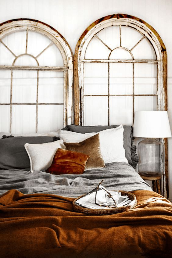 white bedroom with copper orange bedding, pantone potter's clay