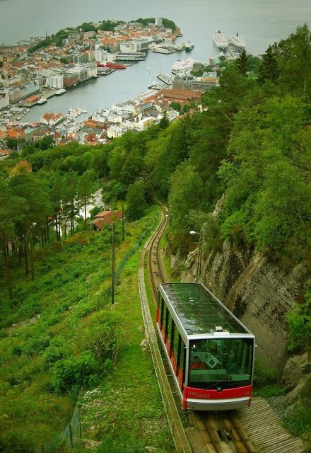 Funicular travel in Bergen. Bergen is a city in Hordaland on the west coast of Norway. The city is surrounded by mountains. For this reason, Bergen is known as the city of seven mountains.