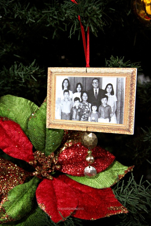 My 2012 holiday project: Turning grandma's Christmas tree into a family tree!    Homemade ornaments using 20 different family photos printed on matte photo paper, mounted on foam board, plus beading. :)