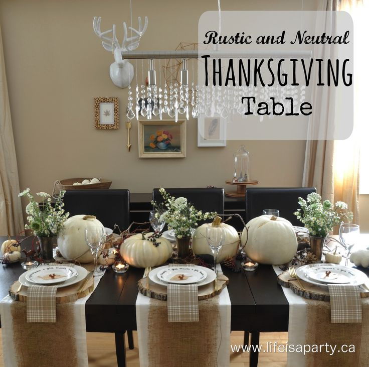 Rustic and Neutral Thanksgiving Table: Beautiful and inexpensive table decorated with wildflowers, little mini animals, tree stumps and white pumpkins. Perfect for a fall dinner, or Thanksgiving.: