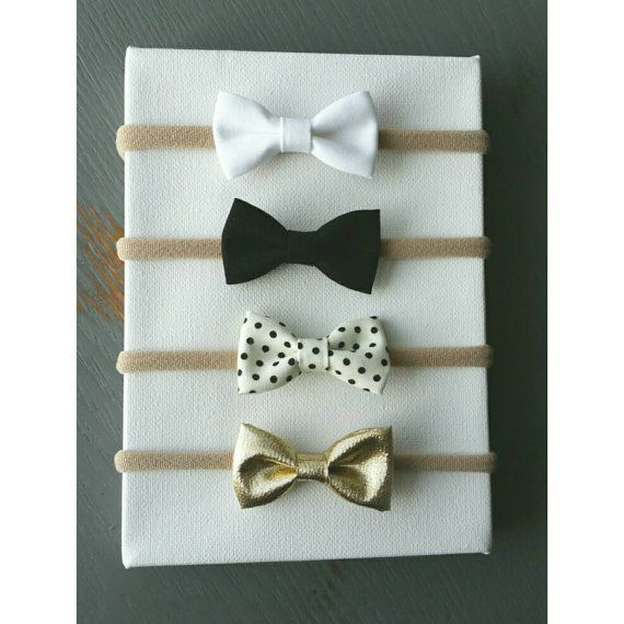 These itty-bitty bows are perfect for your itty-bitty babe! They are great neutral colors (gold is a neutral right!?) and attached to nylon