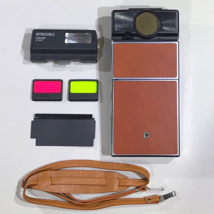 Rebuilt Polaroid SX70 Sonar Autofocus Bundle - Updated to use 600 Film Cartridges - New Flash, Neck Strap, Film and Frog's Tongue Included by UpcycledClassics on Etsy https://www.etsy.com/listing/491329600/rebuilt-polaroid-sx70-sonar-autofocus