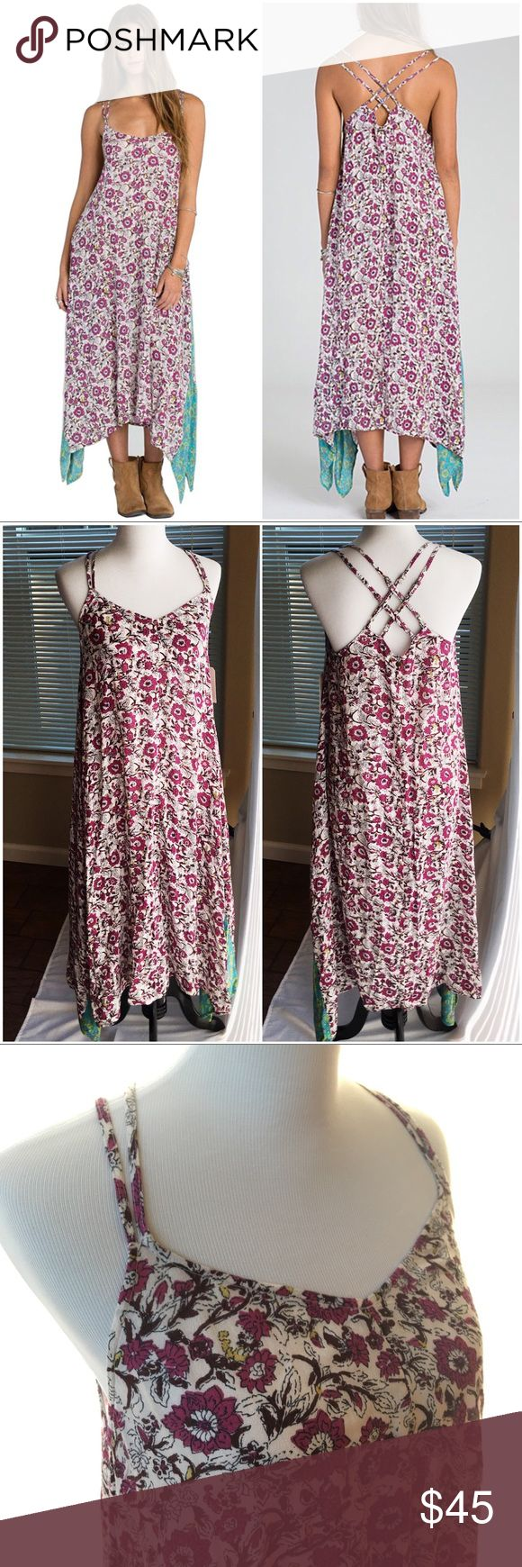 Floral Western Sunset Side-tail Maxi Dress Make your mark as a fashion maven in this swishing sidetail maxi that boasts an adorable criss-cross backline and whimsical contrast fabric at the hem.  Model measurements (size M): 5'10 tall; 32'' bust; 24'' waist; 35'' hips Woven 100% rayon Machine wash Reasonable offers welcome. 20% off bundles! Billabong Dresses Maxi