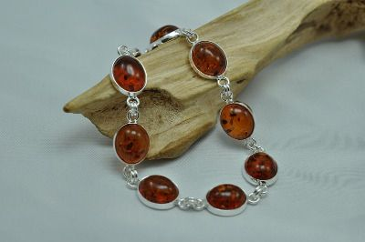 A fashionable and fine looking Baltic amber bracelet with cognac colour oval stones and silver mounting. more at : http://www.jewelinthecrowd.co.uk/ourshop/cat_455786-Amber-Jewellery.html
