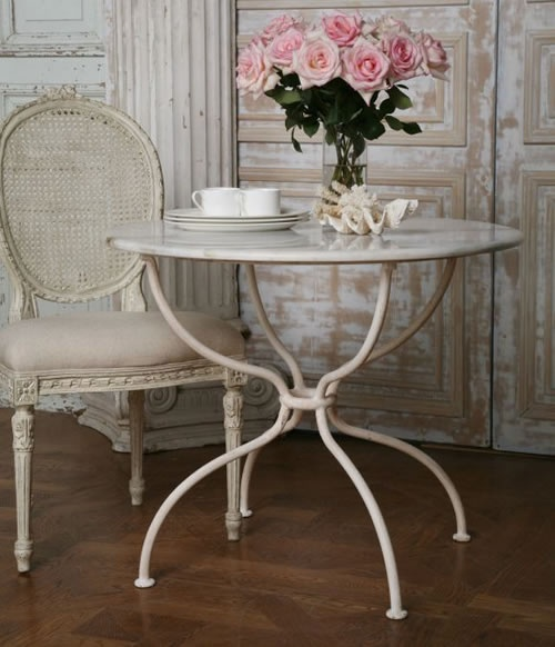 French cafe table with iron base and marble top.