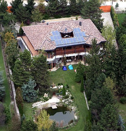 """At Home With Brad and Angelina... Budapest, Hungary Pitt and Jolie are renting a supersecluded 10-bedroom villa in Hegyvidek, Hungary, for their family of six while she directs her Bosnian war film in Budapest this fall. """"This house has absolute peace and quiet,"""" a source tells Us of their new $27,000 per month pad."""