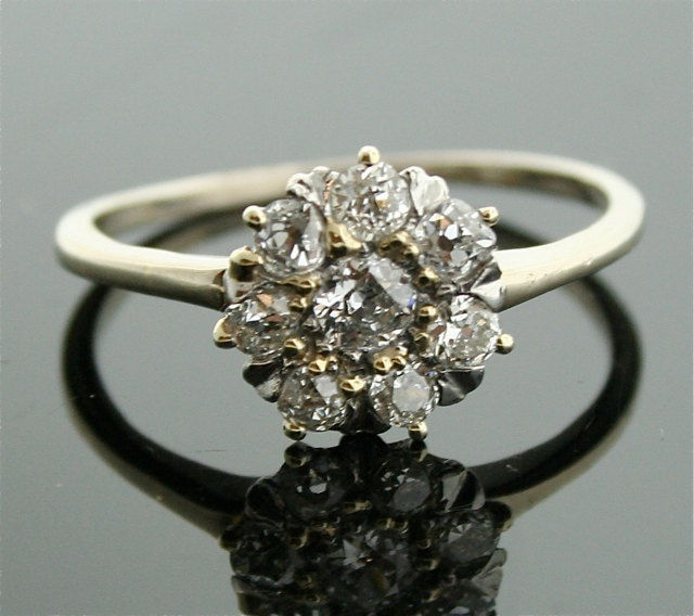 Vintage Diamond Ring - Flower Shaped Diamond Ring. $2,350.00, via Etsy. // Heavens. With that ring on my finger? I could take on the world.