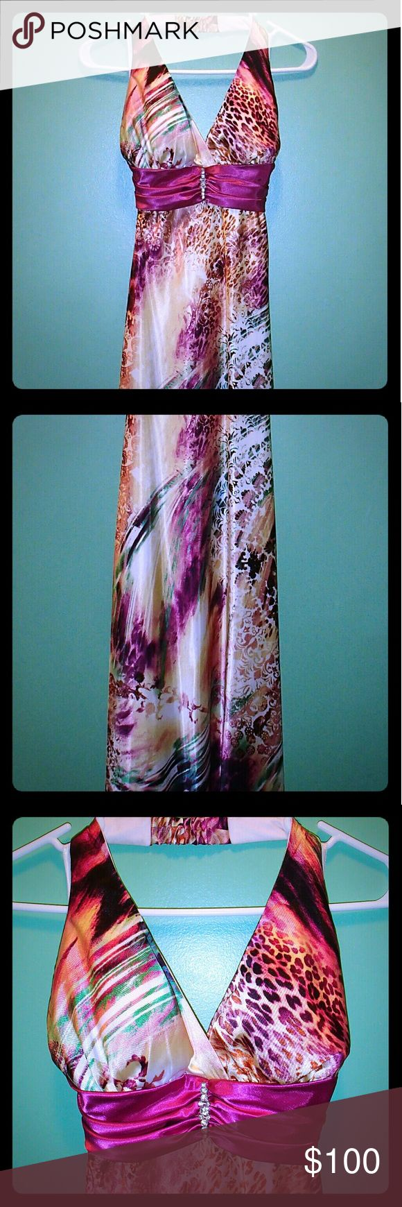 "Gorgeous long halter formal dress Excellent condition!! Only worn once! Smoke free home!  Beautiful animal print & multi-colored design with a diamond accent in the front. Halter style, ties in back & has a 5.5"" zip closure in the back. Fully lined. This dress would be perfect for any formal occasion!  Length = 4' 6-7"" Train of 5"" Taboo Dresses Maxi"