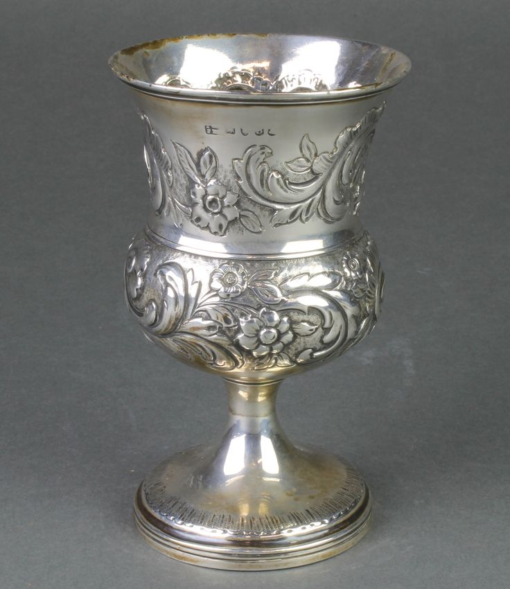 Lot 625, A George III repousse silver waisted goblet with scroll decoration and vacant cartouches, 202 grams, est £100-150