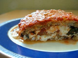 A classic Italian baked eggplant Parmesan casserole with fried eggplant slices layered with Mozzarella, Parmesan, basil, and tomato sauce.