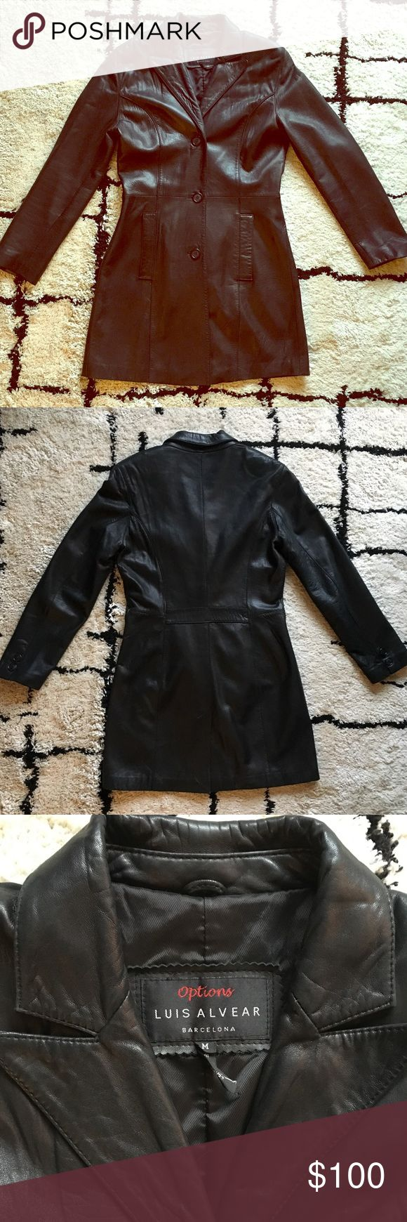 EUC Luis Alvear Black Leather 3/4 length Coat Sz M Luis Alvear Barcelona 3/4 Length 100% Leather Coat * Size Medium * Black color * Fully lined 3/4 length leather coat. Single breasted three button front closure. Two front slit pockets. Back vent * Buttery soft leather. Shell made of 100% leather and lining made of 50% nylon and 50% acetate * Excellent used condition. Tiny white dots on back of right sleeve that could possibly be wiped away with leather cleaner Luis Alvear Barcelona Jackets…
