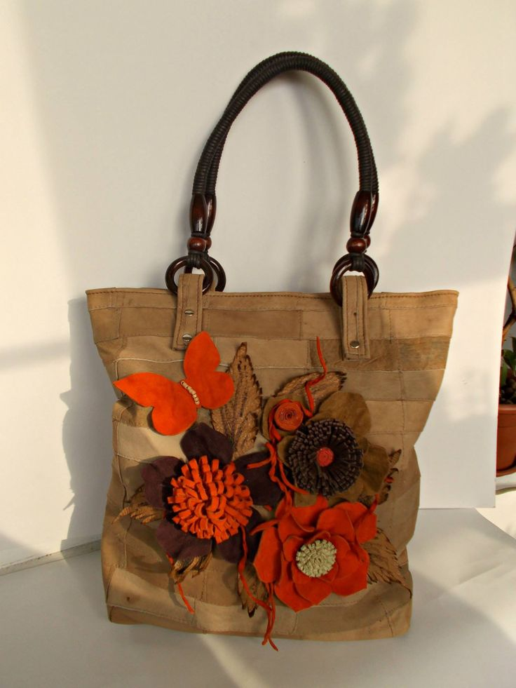 Unique hand-sewn leather bag with flowers