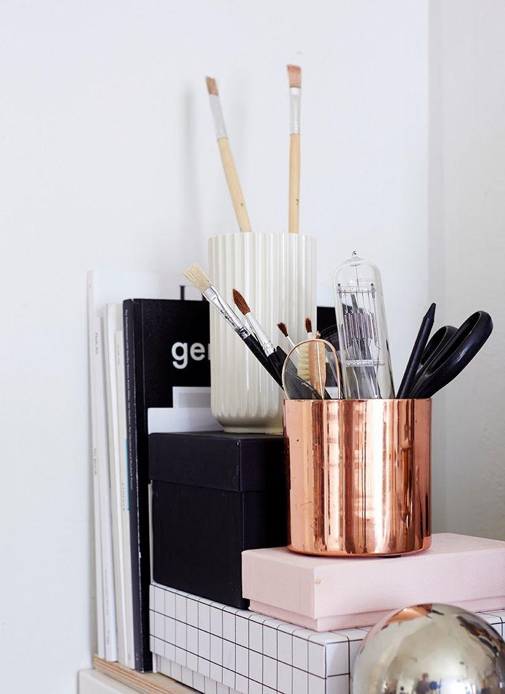 brass pot, paint brush, scissors, books