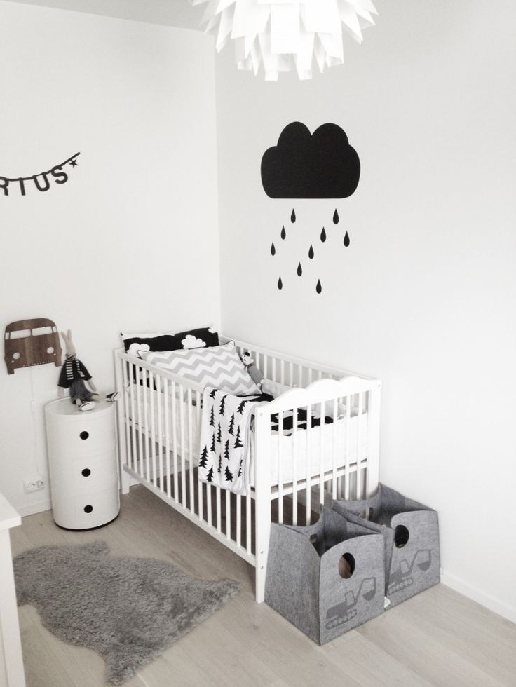 Grey and Black nursery. If this feels too drab opt for a starburst decal instead of a rain cloud. Or throw in a few pops of bright neon colour to make it fun.