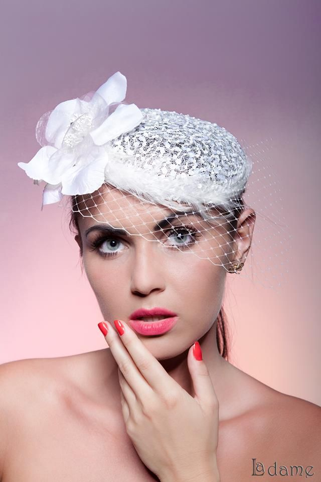 Whiteness- lace toque with veil, flower and feathers