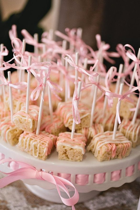 Rice Krispie Treats with white and pink chocolate drizzle- could do green and black bridal shower. Love rice crispies!! One of my faves!!