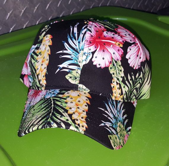 Check out this item in my Etsy shop https://www.etsy.com/listing/496642484/1-of-a-kind-black-hawaiian-hat-loaded