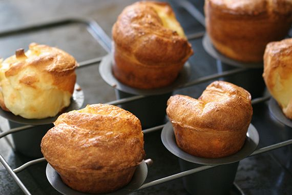 6 popovers  3 eggs  1 c flour  1 c milk  1 tbsp melted butter  1 tsp salt  preheat 450 lowest rack  In a large Pyrex measuring cup, whisk the eggs, flour, whole milk, butter and kosher salt together.  Let the batter rest for at least 30 minutes. Pour 1/2 tsp  oil each slot, heat 5 minutes until the oil gets very hot.  Pull the pan out of the oven and working quickly evenly distribute the batter halfway up each cup.  Place the pan back in the oven and bake for 20 minutes.   350 degrees 15 min