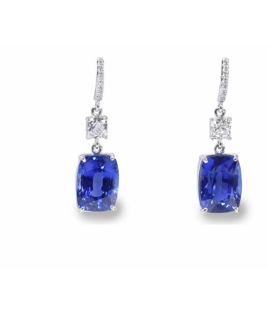 A pair of 16.50 and 12.89 carats cushion-shaped sapphire and diamond earrings. Sold for £ 94.900.