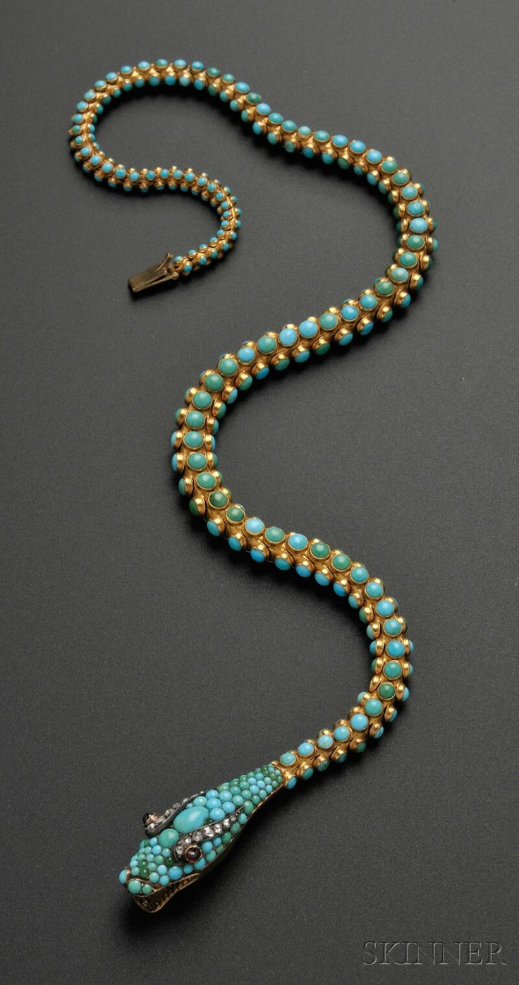 Antique Gold and Turquoise Snake Necklace, the head pave-set with turquoise cabochons, cabochon ruby and rose-cut diamond accents, completed by flexible scale links set with turquoise cabochons; together with a similar pair of earclips; lg. 15 3/4, 7/8 in.