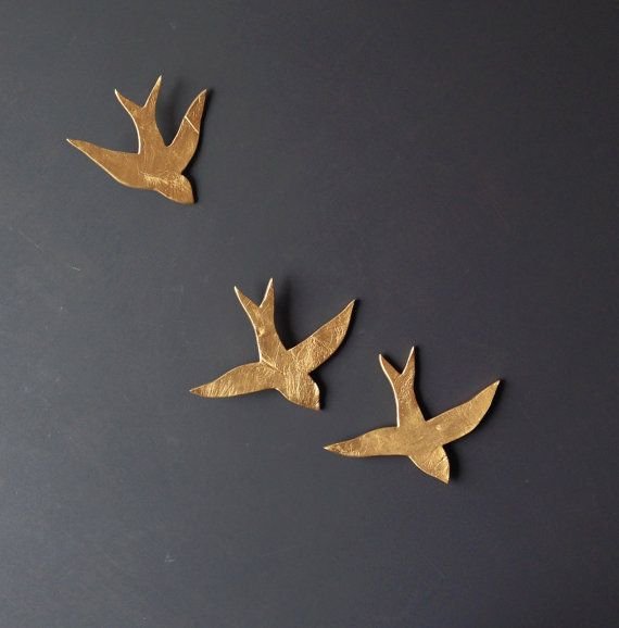 This set of three porcelain swallows have a metallic gold finish and will add rich, dramatic and whimsical style to your wall art. They are made from high-fired ceramic with a gold metallic coloured finish.They are perfect for kitchens and bathrooms because they dont mind a little steam, but theyll look equally cool in living spaces. My favourite place for them is in the bedroom, because they are a flighty, dreamy focus as you fall asleep. Theyre easy to arrange in any way that suits your…