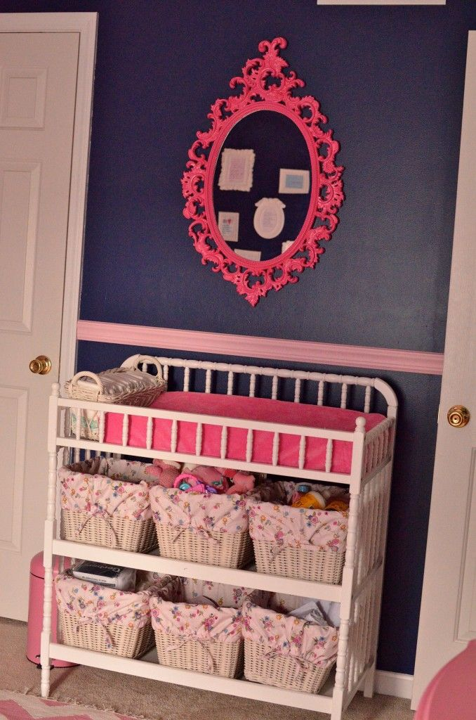 Love the hot pink mirror on the navy wall