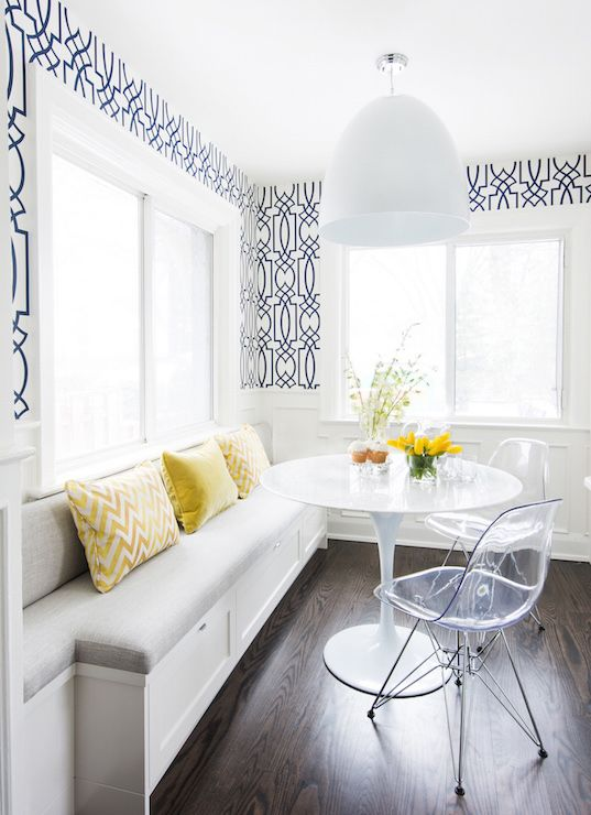 A built- in breakfast nook is the perfect solution to maximize seating in a small kitchen.