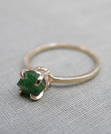 10 k gold with a solitaire emerald stone - This is my birth stone. Have never been crazy about the emerald stone but I like the band, and post.