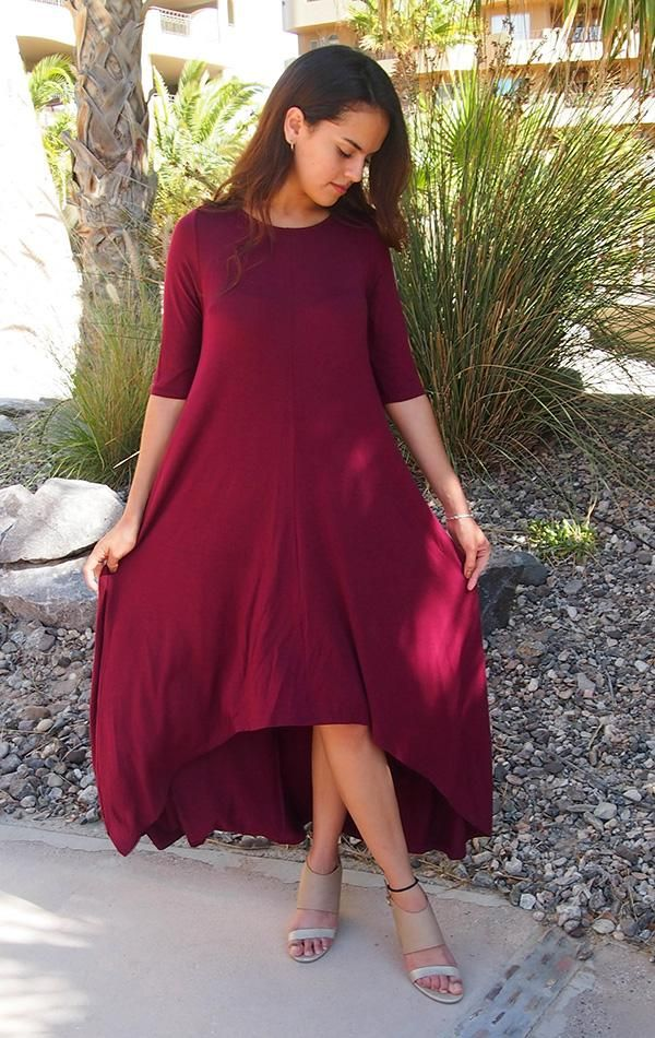 Feel like you are walking on air in our Swept Away Burgundy Red High-Low Maxi Dress. Super soft and stretchy jersey knit shapes a rounded neckline, relaxed fit bodice, three quarter long sleeves, and flowy hi low maxi skirt. Halter maxi dresses, short sleeve maxi dresses, off the shoulder maxi dresses, there is a maxi dress for everyone and every style of Maxi Dresses has it's perks! #maxidress