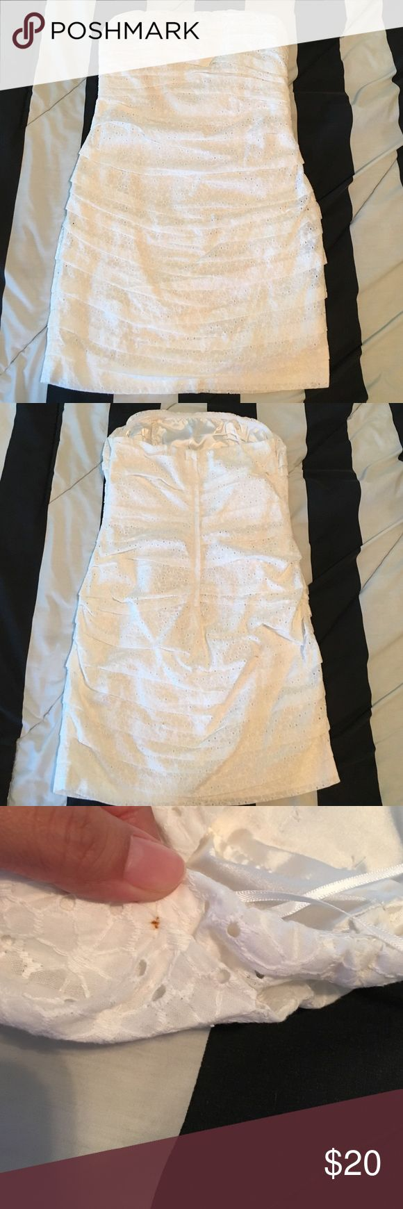 White Express Women's size 10 Beautiful sleeveless white dress. Outside is 100% cotton and lining 97% polyester 3% spandex. Just noticed after taking off the dry cleaner tag it left a small rust stain under one of the folds (pictured) on top because it's hidden it won't be showing when u wear it. Also on the front there are two tiny stains (pictured) it's only noticeable very close up. Used a small safety pin for a point of reference. ⭐️don't forget to bundle for extra savings Express…