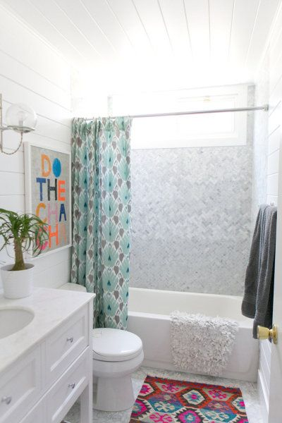 tiny bathroom, all in white with colorful accessories