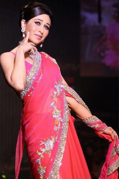 Just like her sister, Karisma too looks a stunner in this red net sari (Photograph- Rajesh Karkera) - bollywoodshaadis.com