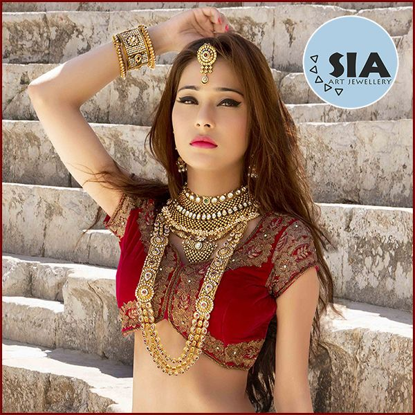 "What an exquisitely crafted piece of jewellery! A lovely Kundan studded with gold color polish ethnic Indian Bridal Necklace Set. This set is adorned and worn by one of the leading television actress in India, Star Plus's one of the most popular show of it's time Sapna Babul Ka - Bidai fame ""Sara Khan""."
